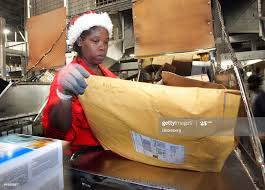 Priscilla Marshall sorts packages at the United Parcel Service... News  Photo - Getty Images