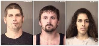 Police find drugs, cash, guns in home; 3 arrested