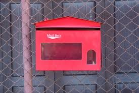 Red Mailbox Hanging On Chain Link Fence Royalty Free Images Photos And Pictures