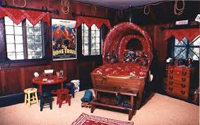 A Cowboys World This Western Inspired Bedroom Has Everything A Young Cow Poke Would Need The Wagonbed Is A Repl Kids Bedroom Decor Cowboy Bedroom Cowboy Room