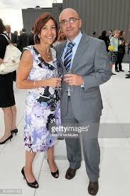 Roseann Smith and Nino Pjetri attend 200 Fifth Avenue - 100th ...