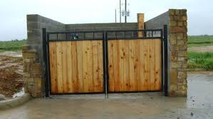 Cedar And Iron Dumpster Enclosure House Gate Design Home Gate Design Backyard Gates