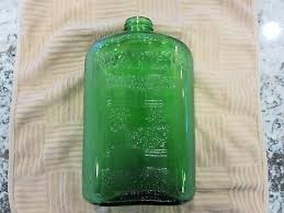 green glass refrigerator water bottle