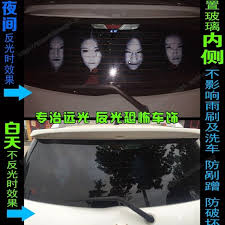 Drivers Using Reflective Scary Face Decals On Rear Window To Discourage High Beam Users Rear Window Decals Scary Faces Window Decals