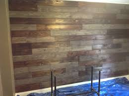 Wood Wall Using Cedar Fencing Burn The Cedar With A Torch To Bring Out Grain And Then Stained Some Board Cedar Walls Cedar Fence Wooden Fireplace Surround
