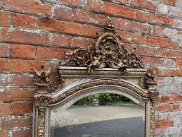 silver and gilded carved wood and gesso