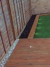 astro turf laying flower beds garden