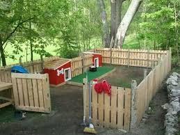 Upcycle Use Pallets To Make A Fenced Area Outside Backyard Dog Area Backyard Diy Projects Backyard Projects