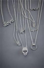 sideways cross pendant necklace