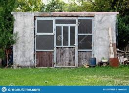 homemade old concrete garden shed with
