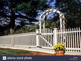 White Picket Fence Arbor And Chrysanthemums In A Basket Monmouth Stock Photo Alamy