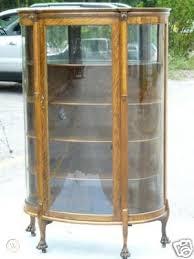 antique 19c tiger oak curved glass