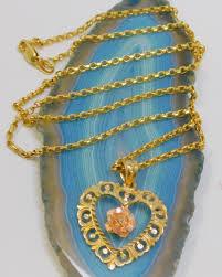 14k gold ornate carved heart pendant