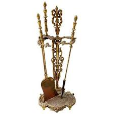 ornate solid brass fireplace tools with