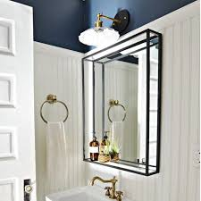 metal framed bathroom mirror with shelf