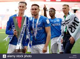 Adam May and Brandon Haunstrup of Portsmouth with the trophy during the  Checkatrade Trophy Final match between Portsmouth and Sunderland at Wembley  Stadium, London, England on 31 March 2019. Photo by Carlton