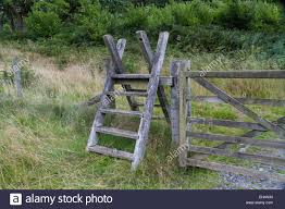 Ladder Over Fence High Resolution Stock Photography And Images Alamy