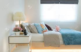 Pink And Blue Blanket With Creative Pillows On Bed In Colorful Stock Photo Picture And Royalty Free Image Image 110521534