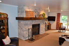 stone fireplace with barn wood mantel