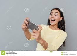 excited young woman playing video games