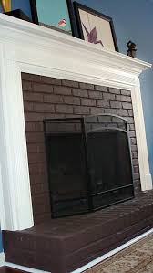 brown painted brick fireplace with