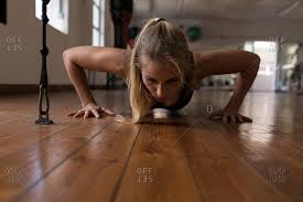 young female boxer doing push ups in