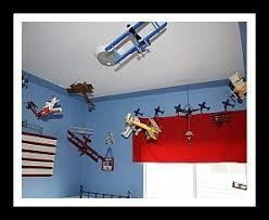 I Love All Of The Models Hanging From The Ceiling Super Cute For An Aviation Themed Nursery Airplane Bedroom Theme Airplane Kids Room Baby Boy Rooms