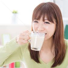 Asian female drinking milk stock photo © WONG SZE FEI (szefei ...