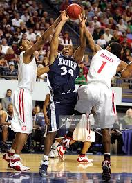 Mike Conley Jr. #1 and Ivan Harris of the Ohio State Buckeyes ...