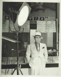 Actor George Raft in a 'Macintosh' suit | Old movies, Classic hollywood,  Rafting