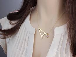 large sideways letter necklace big