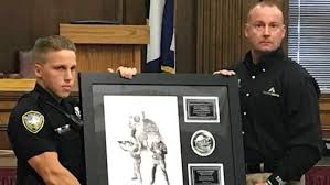 Charleston officer shot in burglary recognized for bravery
