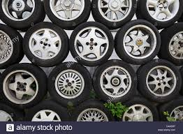 Berlin Germany Car Tires On Alloy Rims As A Fence On Top Of Each Stock Photo Alamy