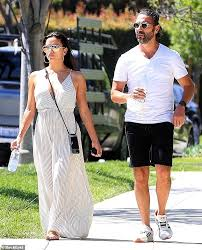 Eva Longoria stuns in a striped maxi-dress as she heads out for ...