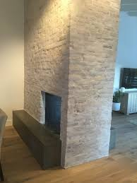 white washed brick fireplace surround