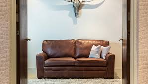 carpet goes with a brown leather sofa