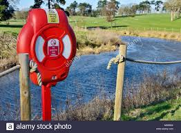 Life Saving Ring Mounted On Post By Rope Fence By River Salwarpe Droitwich Spa Uk Stock Photo Alamy