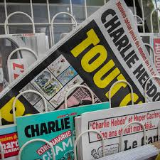 French journalists unite to back Charlie Hebdo after death threats | World  news