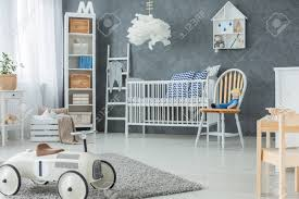 Chair Next To Bed Under Lamp In Grey Kid S Bedroom Interior With Stock Photo Picture And Royalty Free Image Image 115416898