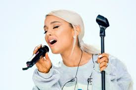 review ariana grande moves on in