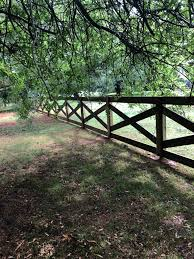 Completed A Wooden X Fence Design Today Faith Fencing And Services Facebook