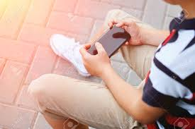 playing games on his cell phone
