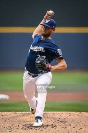 Adrian Houser of the Milwaukee Brewers pitches in the second ...