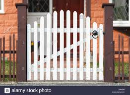 White Wooden Gate And Low Fence Around A Garden Stock Photo Alamy