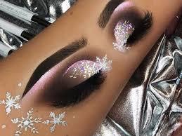 woman draws eye makeup looks on her arm
