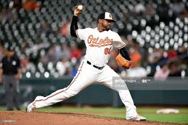 Mychal Givens of the Baltimore Orioles pitches against the Toronto ...