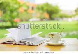 vintage coffee cup book on wood stock