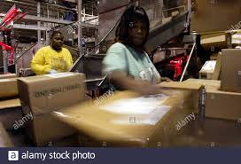 Cardilla Phillips (L) and Priscilla Marshall sort packages at the UPS  facility in Hodgkins, Illinois December