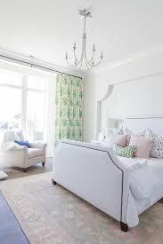 rug under white bed with brass trim
