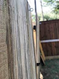 How To Straighten A Leaning Fence Post Without Removing It The Home Finisher